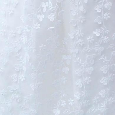 Detail - Spitzenschürze mit Blumenranken